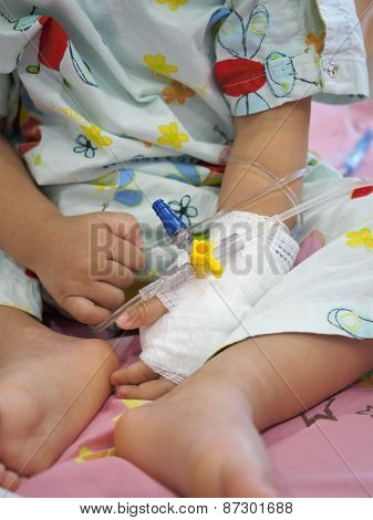 Little Girl On A Drip Receiving A Saline Solution