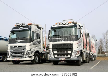Two Modern Volvo FH Logging Trucks