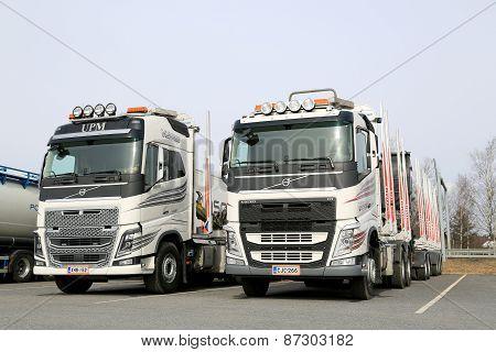 Two Modern Volvo FH Logging Trucks