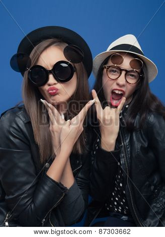 Two girls making funny faces in photo boot