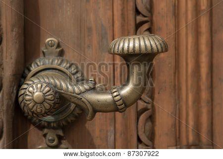door handle on the door of an old building