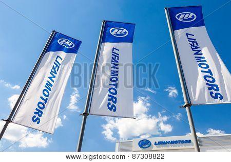 Flags Of Lifan Motors Over Blue Sky