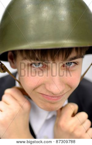 Teenager In A Military Helmet