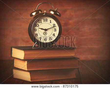 Books With Retro Alarm Clock
