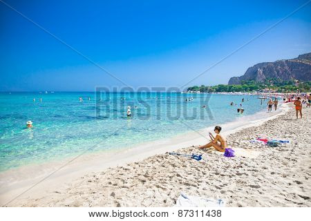 MONDELLO, ITALY - SEP 19, 2014: Unidentified people at the beach of Mondello on Sep 19, 2014 at Sicily. At the end of the 19th century Mondello grew into a favourite tourist destination.