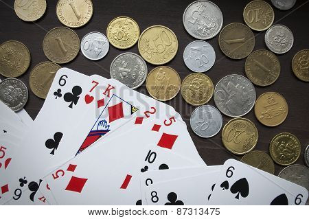 Coins and poker cards top view