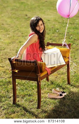 Cute Little Girl On The Bench Outdoor