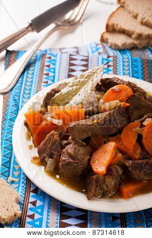Delicious bourguignon beef stew on white plate
