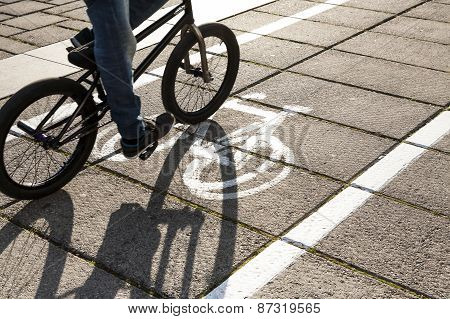 Cyclist on bike path.