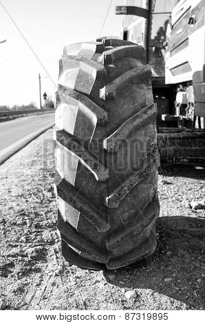 Wheel of an agricultural tractor, detail. Black and white image