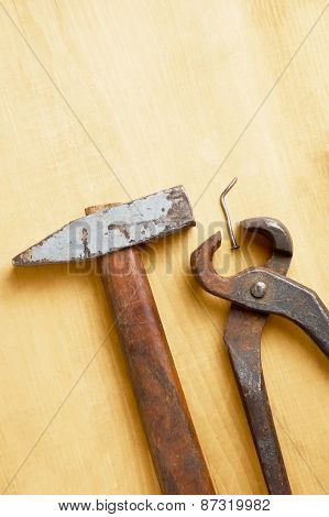 Old Rusty Tools On Wooden Board