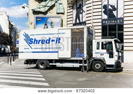 Shred-it Truck Working On Shredding And Confidential Waste Disposal