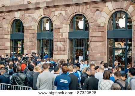 Customers Waiting In Front Of Apple Store
