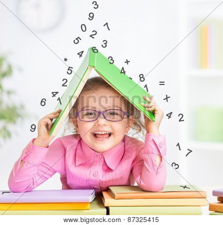 Smart kid in glasses under falling digits