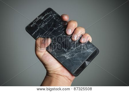Cracked Smartphone Screen On Hand Holding.