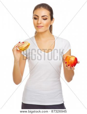 Young girl with apple and hamburger isolated