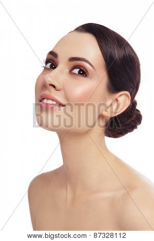 Portrait of young beautiful happy smiling woman looking upwards, over white background