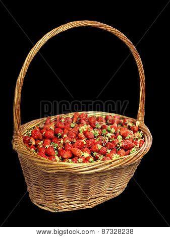basket of strawberries isolate on black