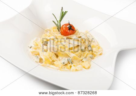 pasta with dorblue cheese on a white plate