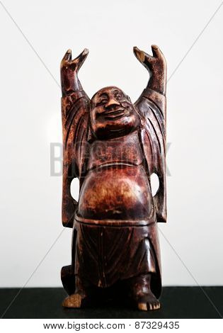 Wood sculpted Buddha