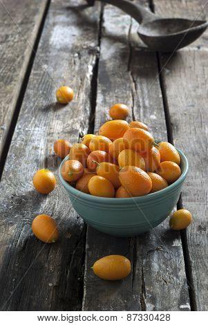 kumquats on a rustic table