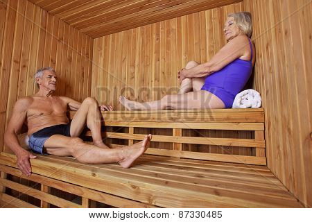 Senior people sitting sweating and relaxed in a hotel sauna