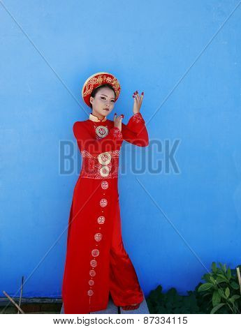 beauty young vietnamese woman in red national ethnic costume
