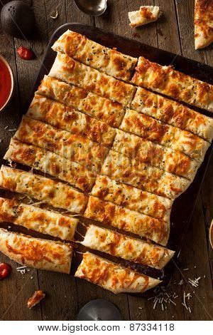 Homemade Cheesy Breadsticks With Marinara