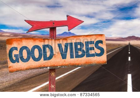 Good Vibes sign with road background