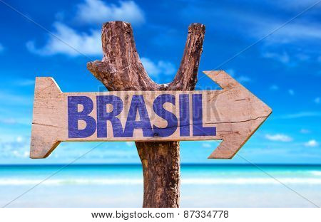 Brazil (in Portuguese) wooden sign with beach background