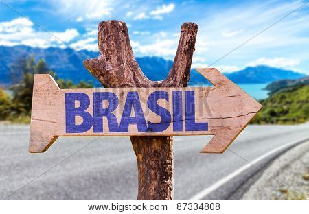Brazil (in Portuguese) wooden sign with road background