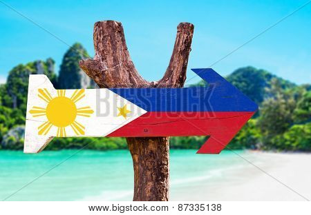 Philippines Flag wooden sign with beach background
