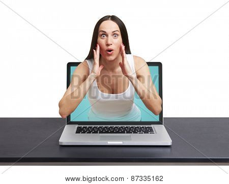 surprised woman got out of the laptop against white background