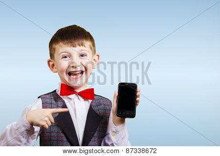 Smiling Happy boy holding mobile phone.