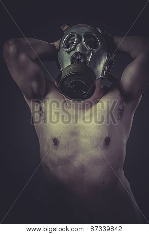 Toxic, concept of risk of contamination, naked man with gas mask
