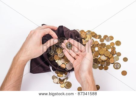 two man's hands holding a gold coins. isolated