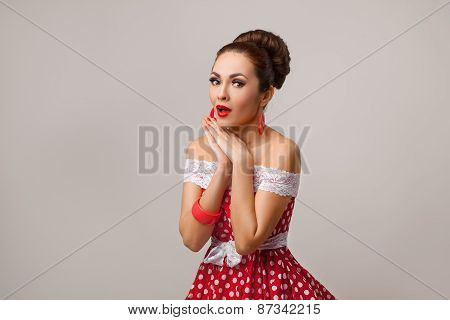 Happy Woman Posing in studio, surprised emotion. Pin-up retro style.