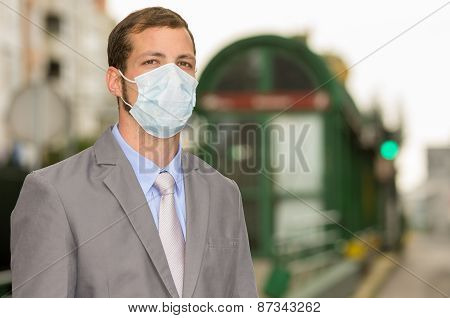 young man walking wearing a mask in city street concept of polllution