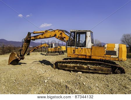 Old And Rusty Excavators Digging