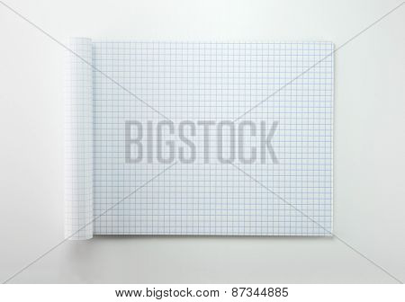 Graph paper with rolled front pages, on natural white background