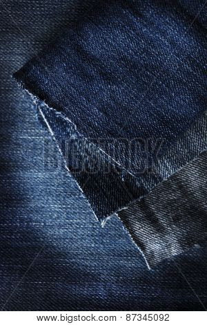 Blue denim jeans fabric macro, close up.