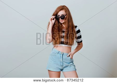 Portrait Of Beautiful Sexy Young Girl In Jeans Shorts And Sun Glasses