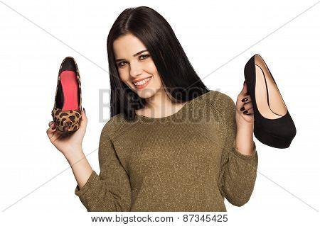Smiling Woman Holding Two Shoes In Her Hands