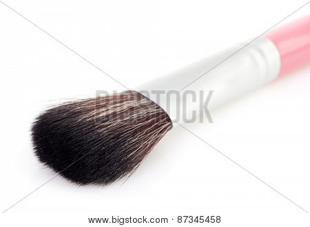cosmetic brush on a white background
