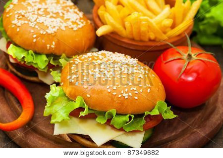 Hamburger with french fries and tomato