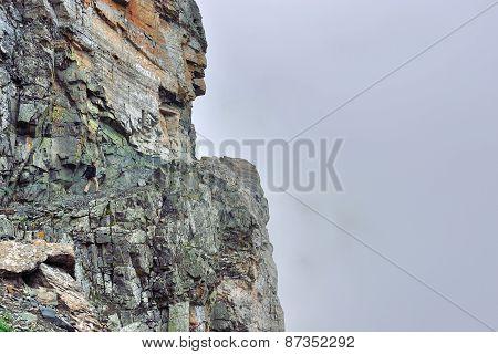 Female Hiker On A Steep Alpine Trail In Heavy Fog