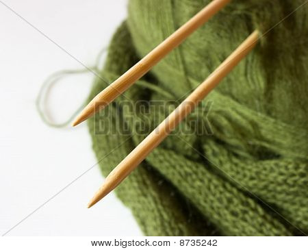 thread and knitting needles