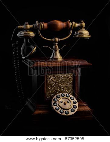 vintage rotary phone on a black background