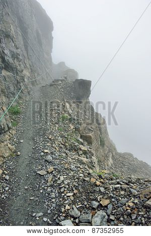 High And Steep Alpine Trail And Heavy Fog In Glacier National Park