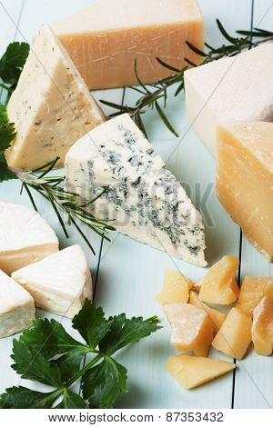 Assorted cheese on wooden table, rich and healthy breakfast or snack